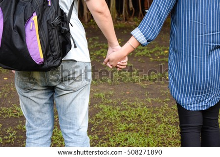Asian Man and Woman Hand in Hand Together