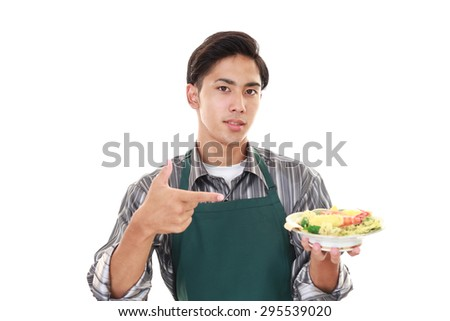 Asian man carrying a meal