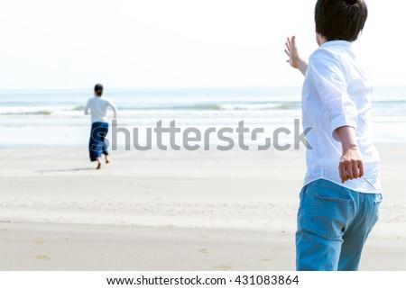 Asian man chasing his girlfriend - stock photo