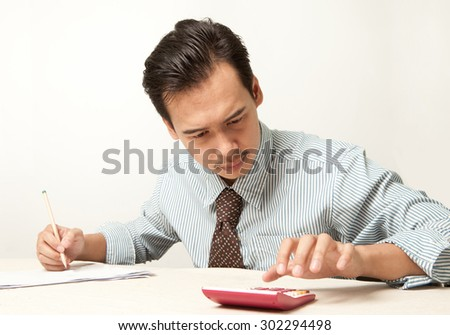 asian man checking finance. - stock photo