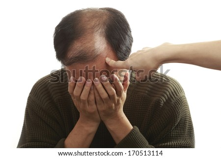 Asian man covering his face with both hands, being blamed,  on white background, - stock photo