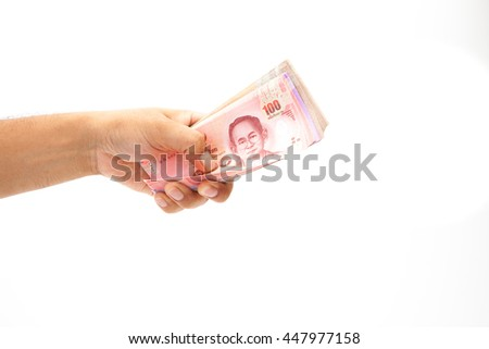 Asian'man Hand holding thailand banknote on white background isolated