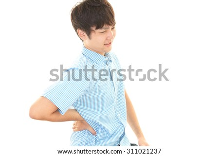 Asian man having back pain