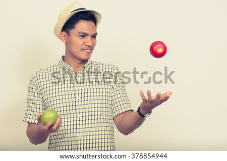 Asian man holding apple