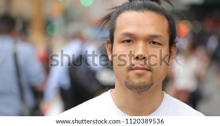 Asian man in city face portrait
