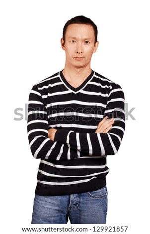 Asian man in striped pullovert, looking on camera, with folded hands