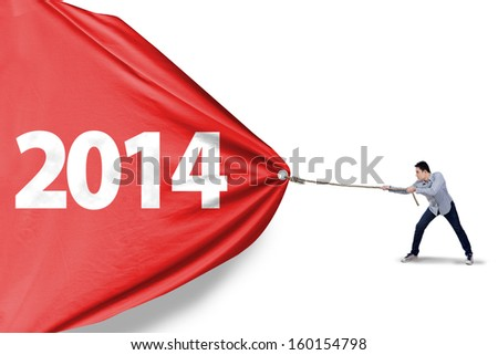 Asian man is pulling new year of 2014 to change the new future - stock photo