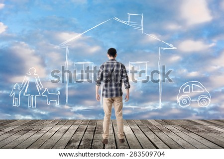 Asian man look toward the drawing house and family in the heaven. - stock photo