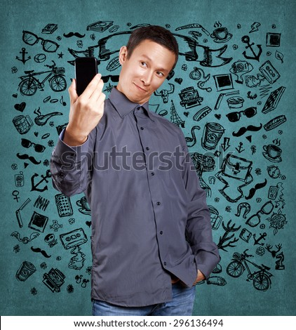 Asian man making a selfie on cell phone to social network - stock photo