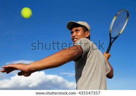 Asian man player tennis With sky blue - Sport Concept
