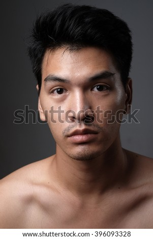 Asian man portrait with no makeup show his real skin in grey background - soft focus