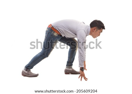 Asian man ready to run. - stock photo