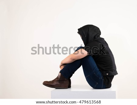 Asian man, sitting with emotional acts.