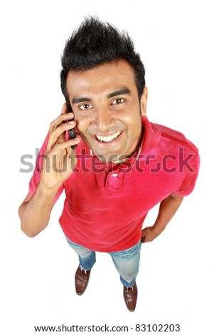 Asian man smiling using a mobile phone as a mode of communication - stock photo