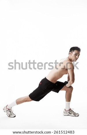 Asian man stretching on background