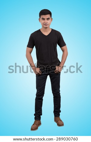 Asian man wearing blank black t-shirt and jean pant isolated on blue sky background - stock photo