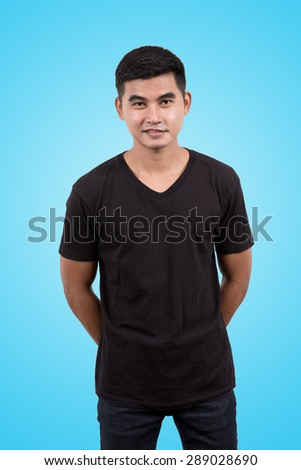 Asian man wearing blank black t-shirt isolated on blue sky background