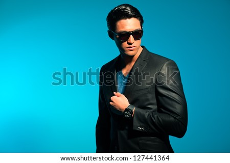 Asian man wearing suit and sunglasses. Summer fashion. Studio. - stock photo