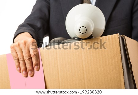 Asian man with a moving box and pink slip - stock photo