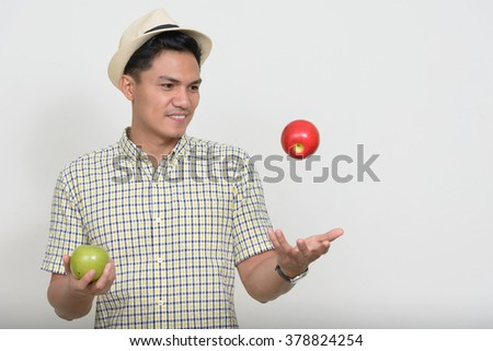 Asian man with apple