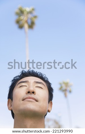 Asian man with eyes closed - stock photo
