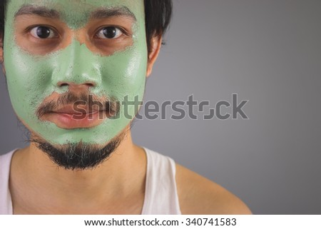 Asian man with face mask skincare.