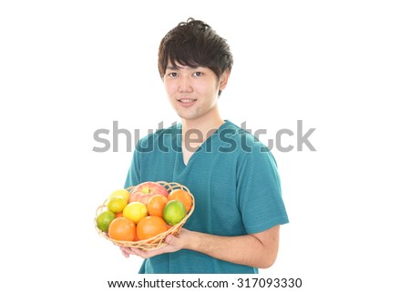 Asian man with fruits - stock photo