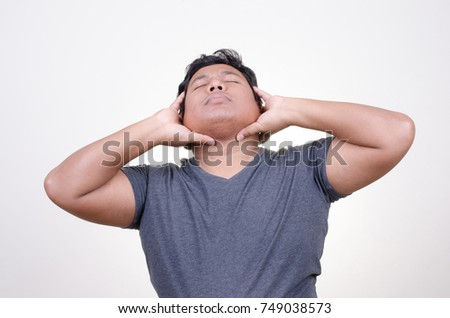 Asian man with neck pain expression