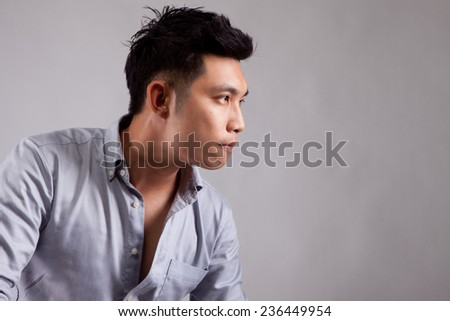 Asian man with vision eyes and strive - stock photo