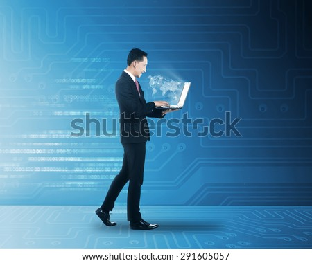 Asian man working with laptop with world map networking. Globalization concept