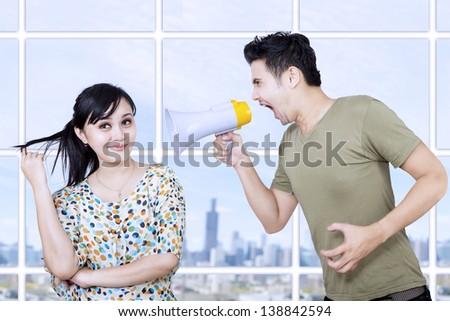 Asian man yelling at his ignorance girlfriend - stock photo
