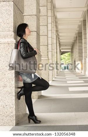 Asian mature woman at street, full length portrait. - stock photo
