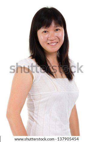 Asian mature woman smiling happy portrait. Beautiful mature middle aged Chinese Asian woman isolated on white background. - stock photo