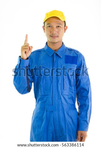 asian mechanic man in coverall thumps up with car service background good service concept