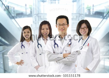Asian medical team standing inside hospital building - stock photo