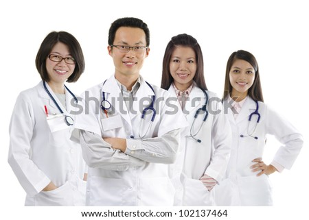 Asian medical team standing on white background - stock photo