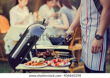 Asian men are cooking for a group of friends to eat barbecue - stock photo