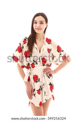asian model in bathrobe with roses isolated on white close up portrait - stock photo
