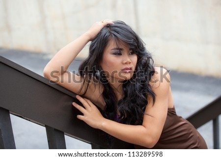 Asian Model Leaning on Stairs