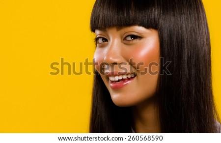Asian model smiling. - stock photo
