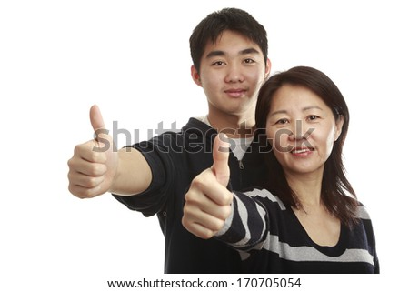 Asian mom and son showing thumb up on a white background - stock photo