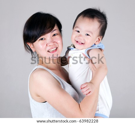 asian mother and baby boy - stock photo
