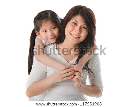 asian mother and daughter bonding and having a good time - stock photo
