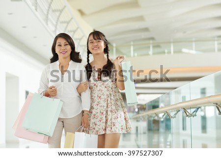 Asian mother and daughter enjoying their time in shopping mall