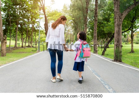 Asian mother and daughter student walking to school.Pupil student.