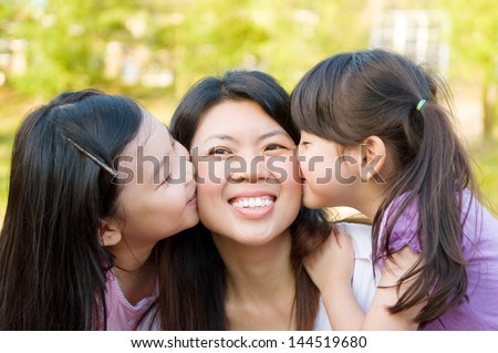Asian mother and daughters - stock photo