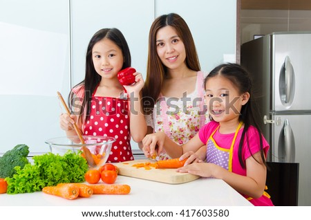 Asian mother and daughters enjoyed cooking in the kitchen