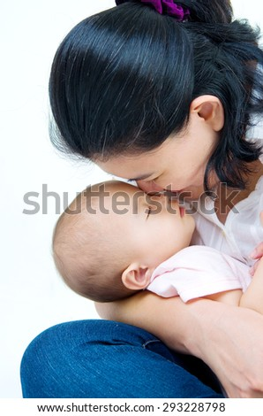 Asian mother and her baby girl. - stock photo