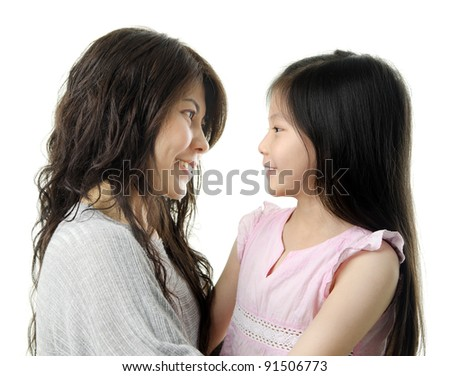 Asian mother and her daughter face to face on white background - stock photo