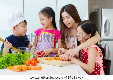 Asian mother and kids enjoyed cooking in the kitchen